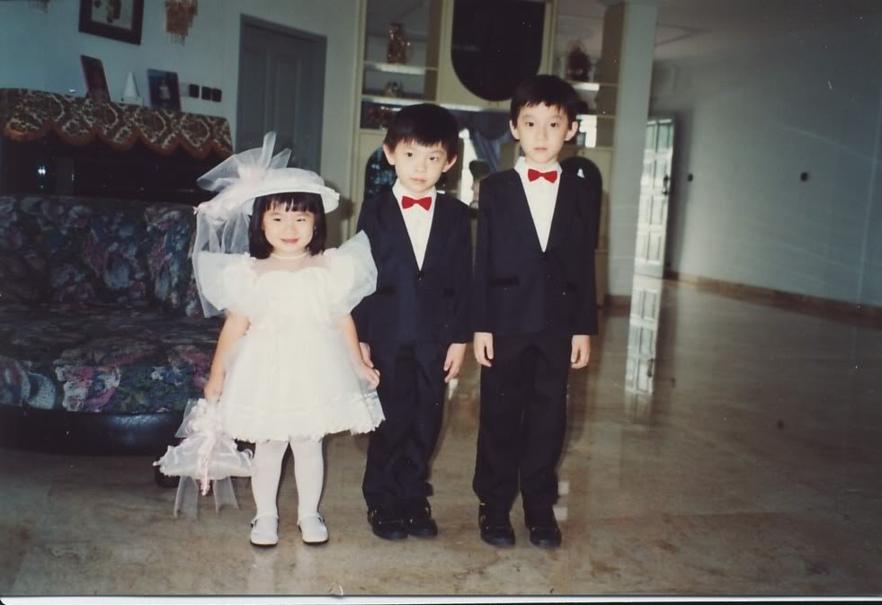 I was 2, Jeffrey was 5, and Vincent was 8. They both kissed me on the cheek in a couple of other photographs. I love them too.